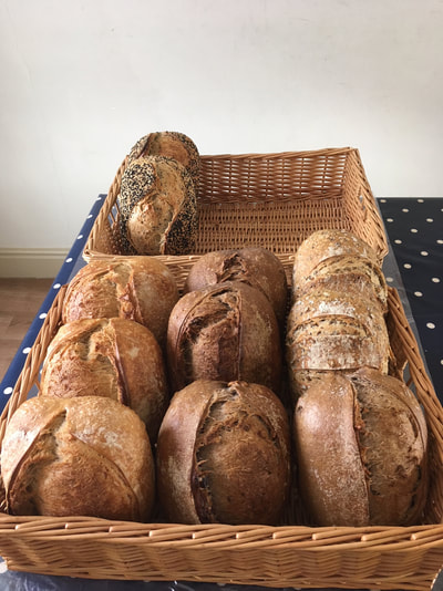 First week: 11 breads on order and just enough to need 2 baskets